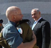 Noam Shalit embraces his son after more than five years of laboring for his freedom.