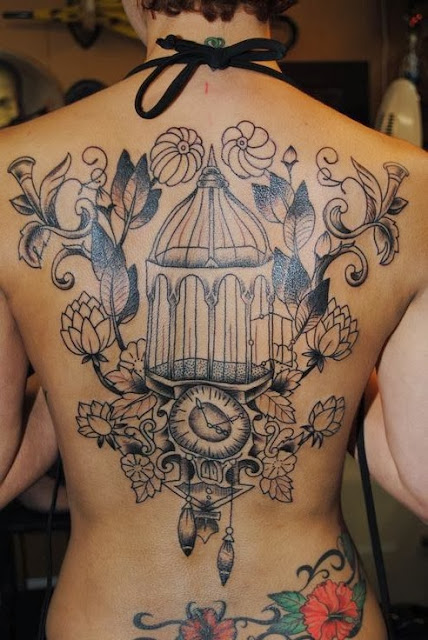 Full size cage vintage tattoo on the back