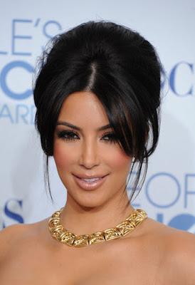 Fashionista Kim Kardashian glamorous style flawless makeup.