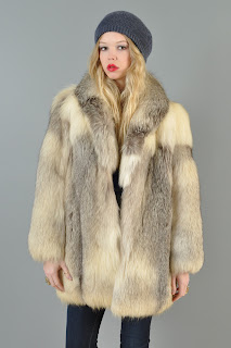 Vintage 1970's dimensional cream colored fluffy fur coat.