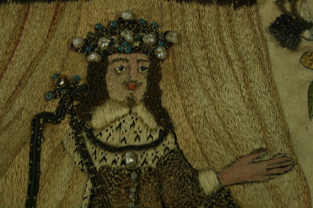 Close-up showing the detail of the embellishments to the 17th century English stump work embroidery, recently conserved by textile preservation experts, Spicer Art Conservation