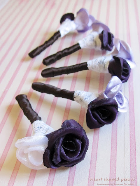 Boutonnieres in pink and lilac