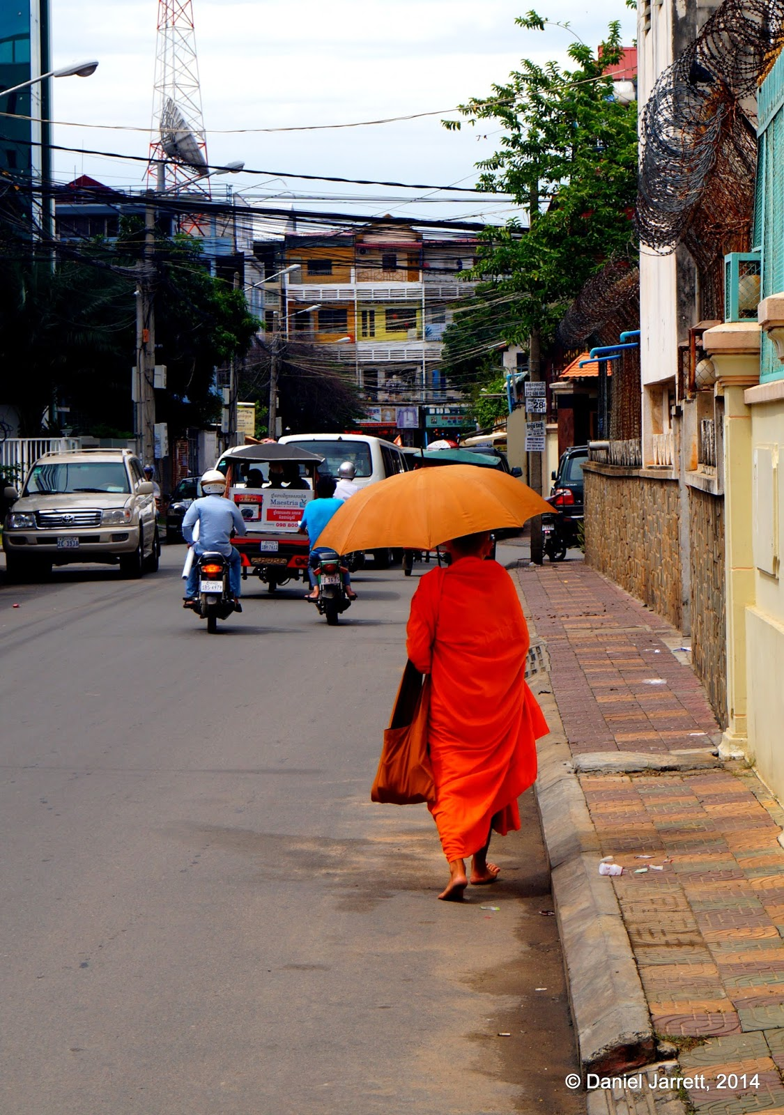 Monk on morning alms, Phnom Penh, Cambodia