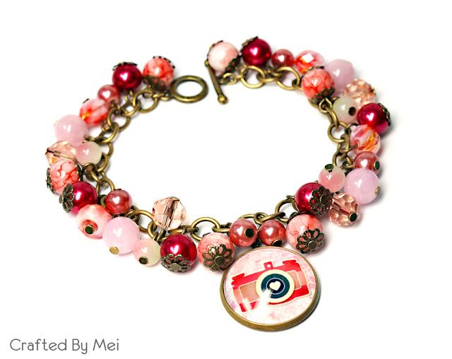 pink, peach camera bracelet