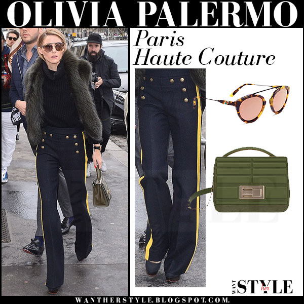 Olivia Palermo in black fur gilet, navy yellow side stripe joseph pants with olive green bag elie saab poincare what she wore fashion week streetstyle