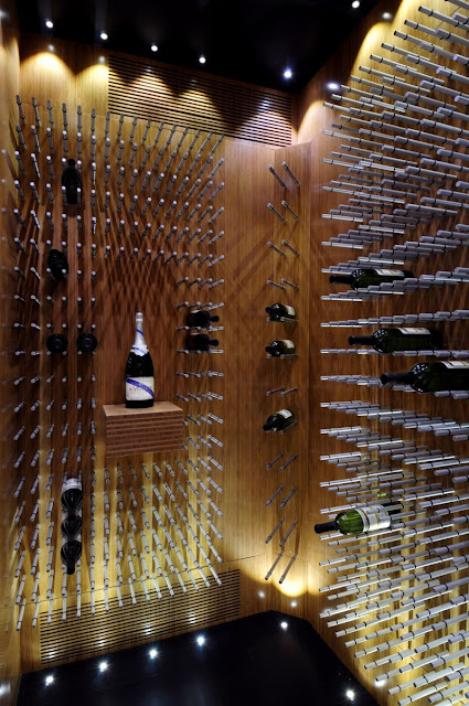 Picture of vine bottles on the walls in the vine room