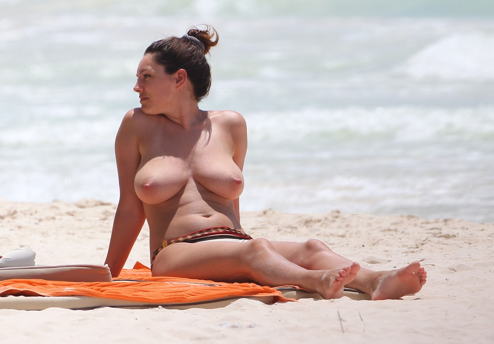 sexy beach exhibitionist warms naked vagina in the sun at nude beaches