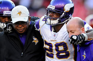 Running back Adrian Peterson #28 of the Minnesota Vikings is helped off the field after being injured in the third quarter against the Washington Redskins at FedEx Field on December 24, 2011 in Landover, Maryland. (December 23, 2011 - Source: Patrick Smith/Getty Images North America)