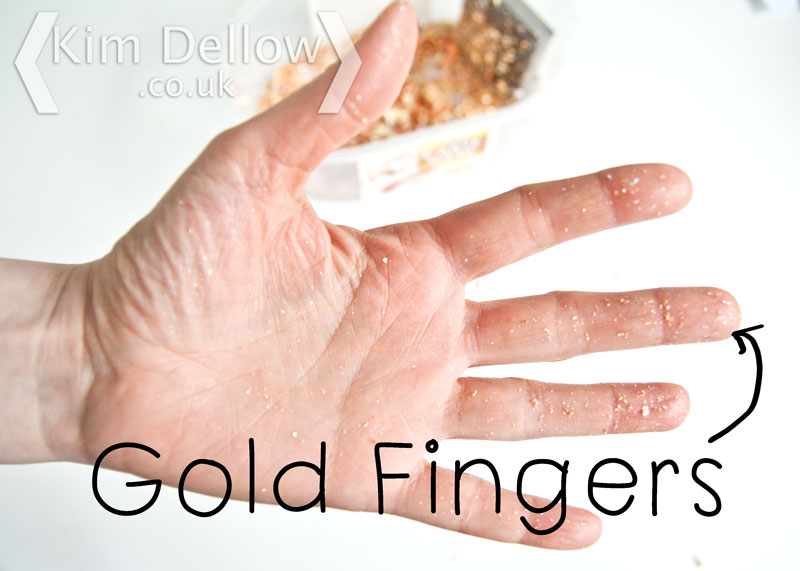Gold Fingers Fingers covered in Gilding flakes
