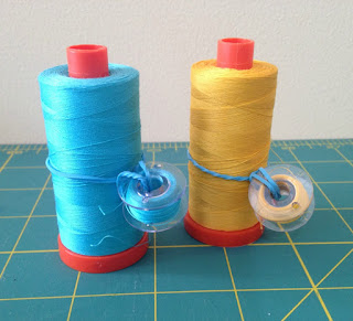 Use a rubber band to keep bobbin and spool together
