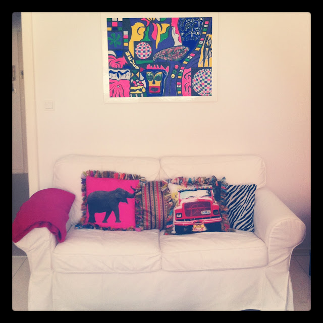Ikea Sofa, indian cushions, my best painting
