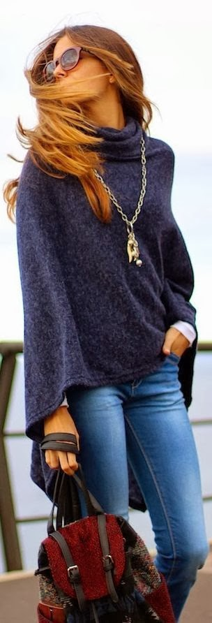 Stylish dark blue cardigan, denim and handbag