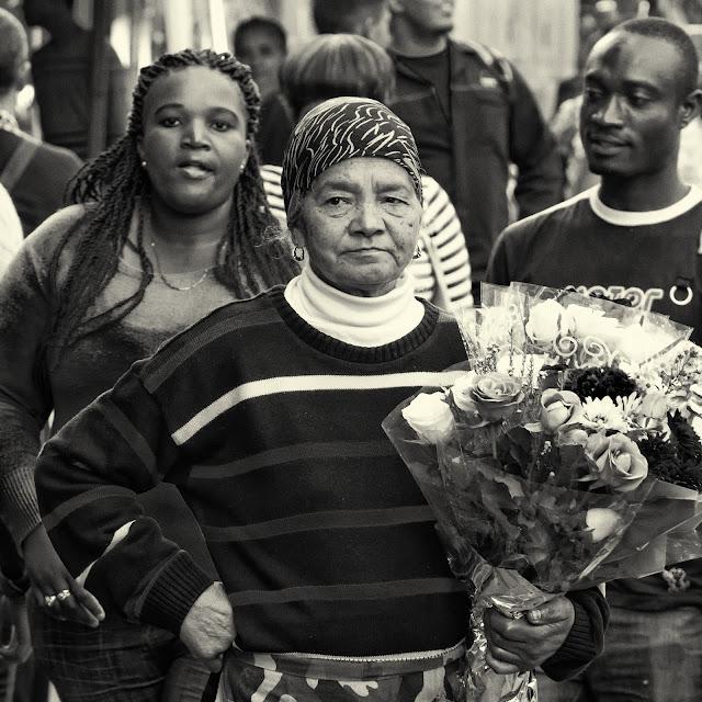 A flower seller outside the Cape Town flower market