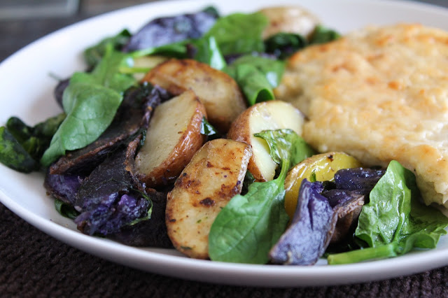 roasted potato medley with spinach, purple, red, yellow potatoes, rosemary