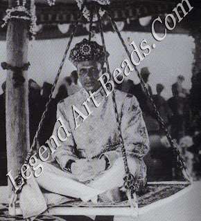Jey Singh Kachwaha, Maharaja of Alwar, who shopped in the Rue de Rivoli for his clothes, was also fiercely traditional. Here, in 1929, he re-enacts the Mughal ceremony of determining his weight in coins for distribution to the poor.