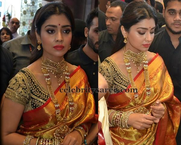 South Indian Actress Shriya Saran Wearing Gold Bridal Saree In Kanjeevaram Silk Meena Work Printed Flowers Embellished All Over And Paisley Design