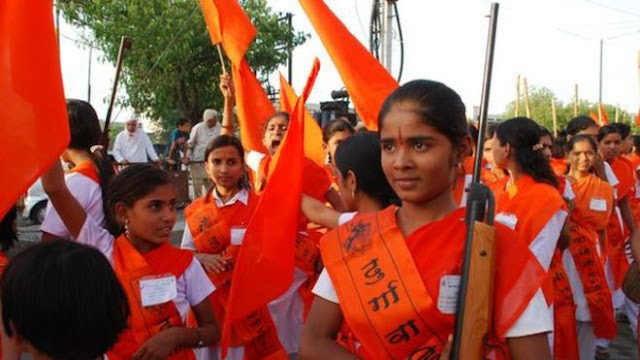 girls with guns and flags of a rss organization