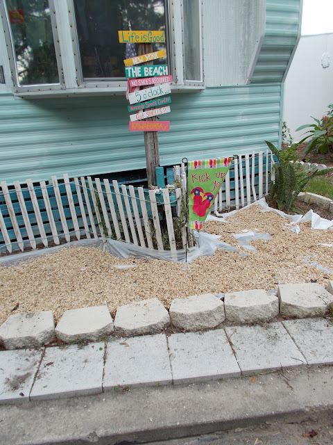 coquina shells, DIY, build a beach, landscpaing with sea shells, dune fence, directional pole,