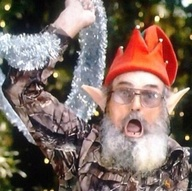 Elf Si Robertson with Tinsel
