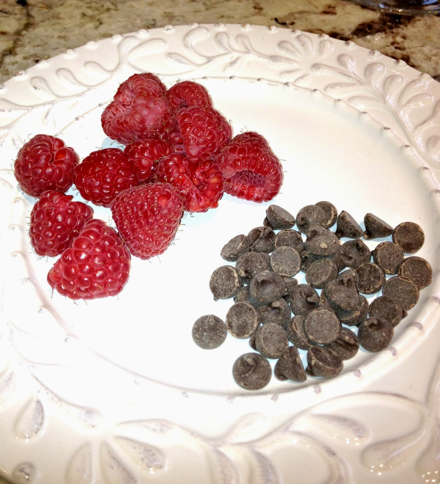 plate of red raspberries and dairy free chocolate chips