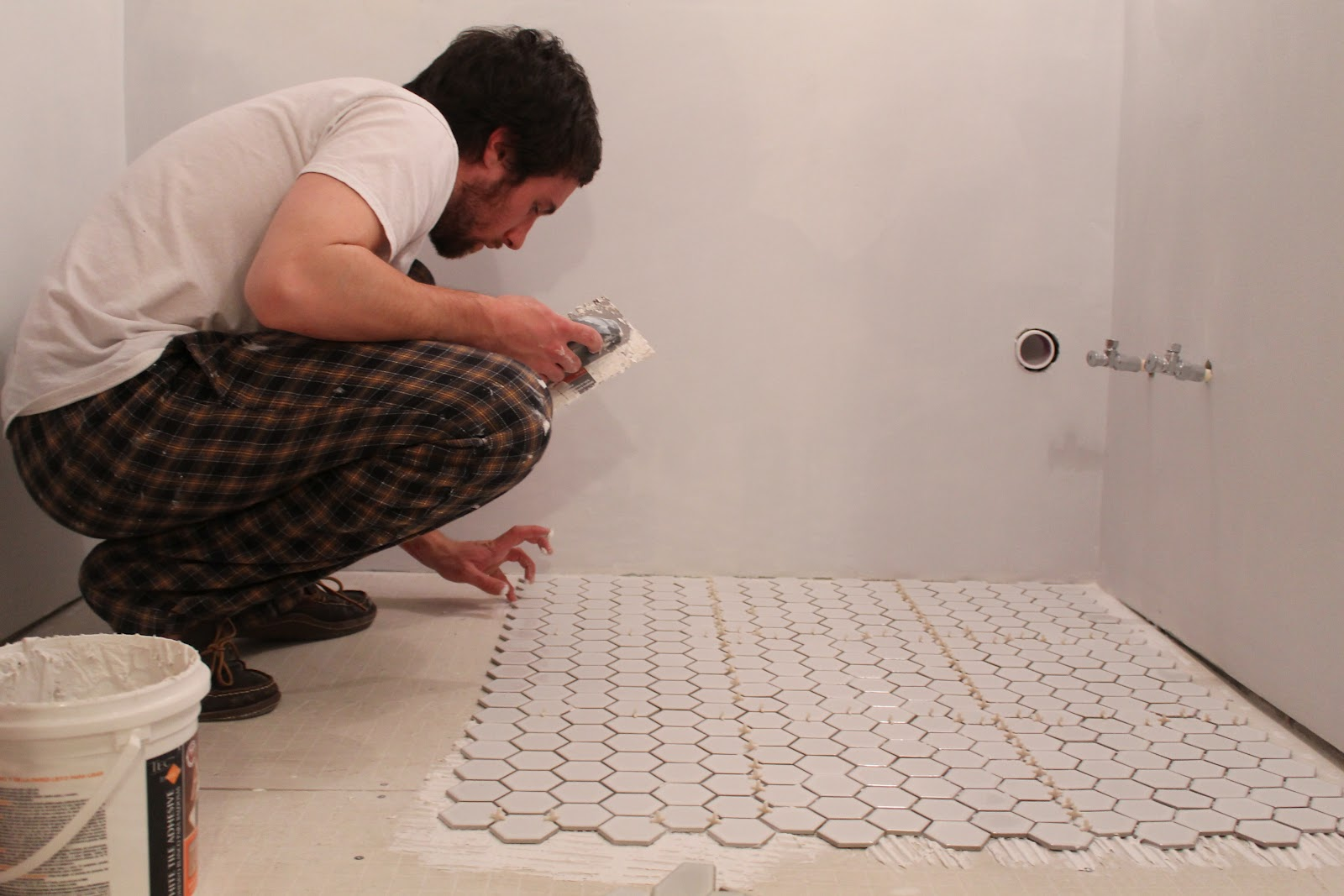 Look At This Fellow Tiling His Bathroom Floor. What A Shit Show. Look What  He Is Doing.