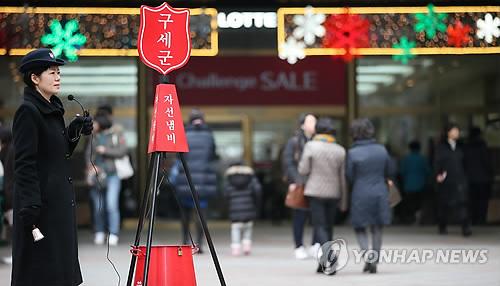 Calderos rojos de la Salvation Army en Navidad, en Seúl