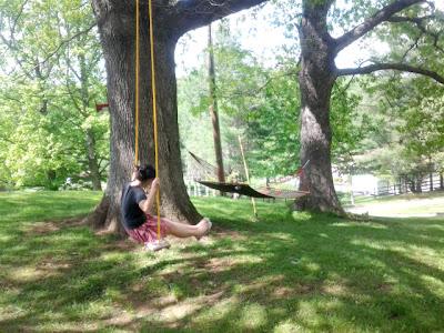 Tomoko swings on the farm swing I hung in Fleetwood, NC / Jefferson, NC