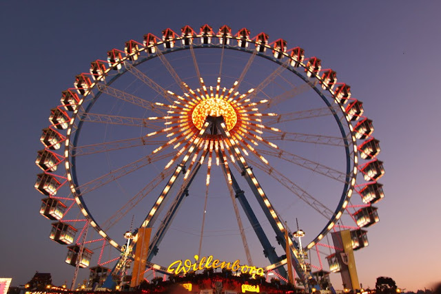 Illuminated Ferris Wheels at Octoberfest in Munich, Germany