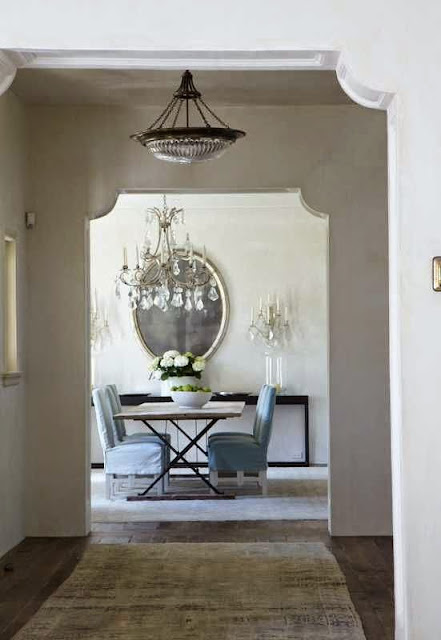 traditionally decorated white foyer and dining area