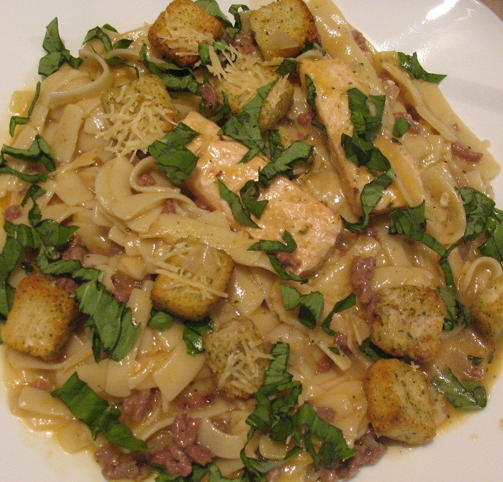 Fettucini Alfredo topped with Basil and Croutons
