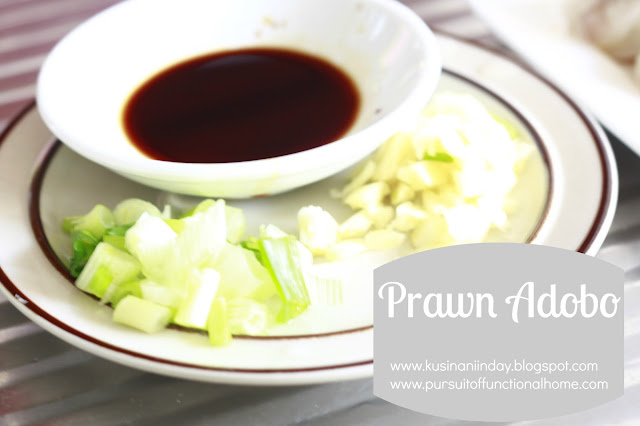 Prawn Adobo. Ingredients Soy sauce, spring onions and garlic