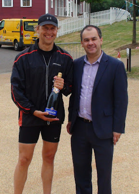 Paul Scully MP presents the prize to the Hamptons Fun Run winner
