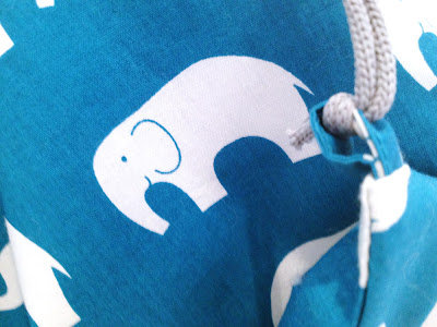 teal bag, white elephant detai : cord loop