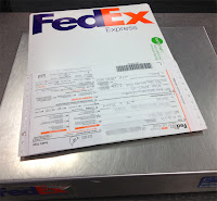 Flying Dogs To Italy : Our FedEx package heading to Austin to gain our dogs' clearance for travel to Italy