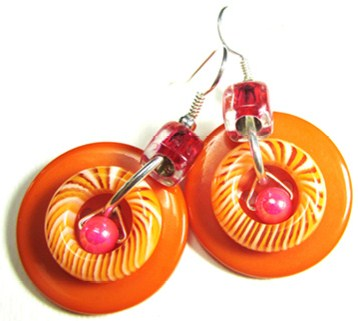 Cool earrings combine swirl donut shapes, accent beads and big buttons