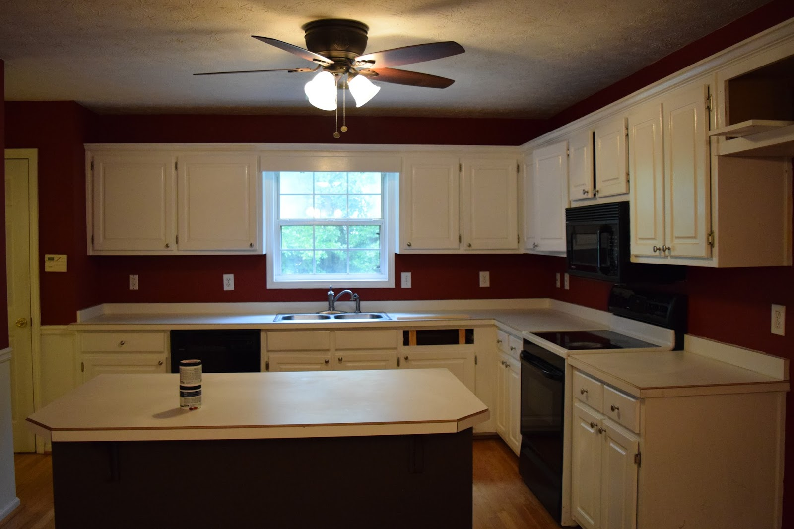 the walls were maroon on top white below the chair rail white laminate counters white cabinets black appliances no refrigerator and a chocolate brown - Maroon Kitchen 2015