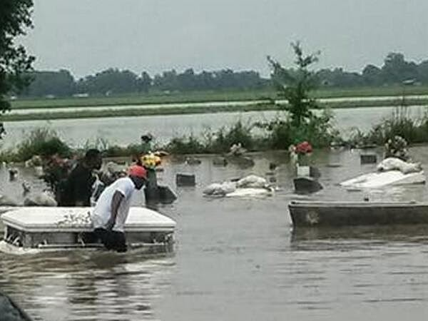 Massive flooding causes caskets to float away from graves. (Credit: WAFB) Click to enlarge.