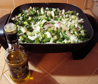 Frying Pan with Onions and Garlic, and Olive Oil Bottle