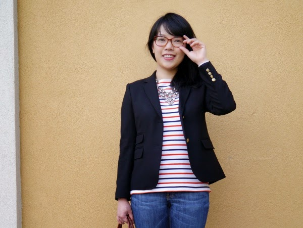 An outfit composed of basics: stripes, denim, black blazer, and some sparkle
