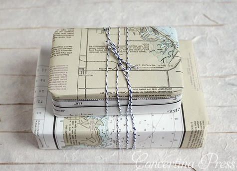 presents wrapped in nautical charts with striped twine bows from Concertina Press