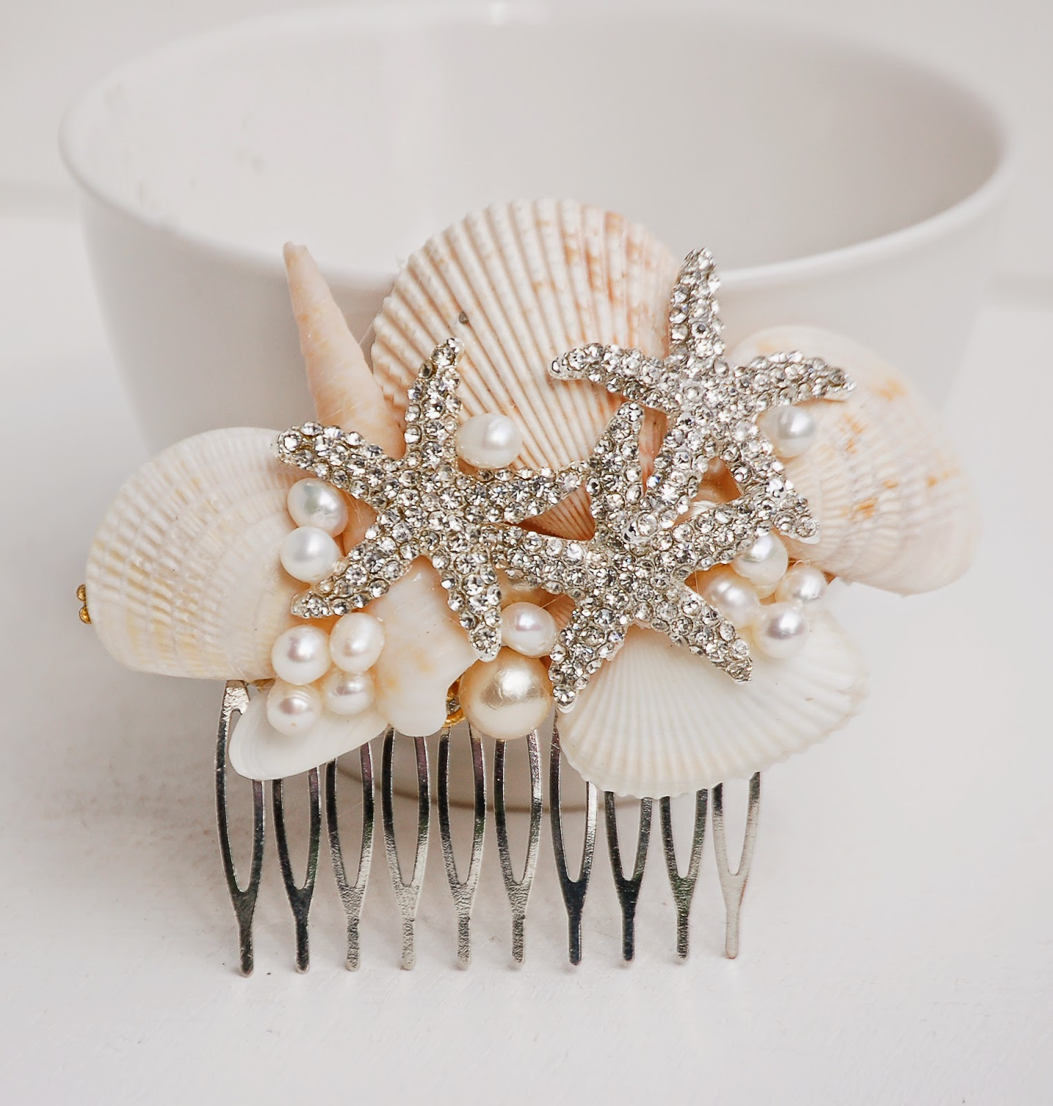 https://www.etsy.com/listing/224615160/bridal-hair-comb-sea-shell-hair?ref=shop_home_active_2&ga_search_query=shell