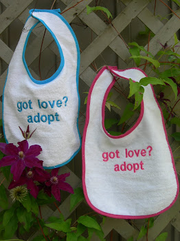 "NEW ""got love?"" bibs"