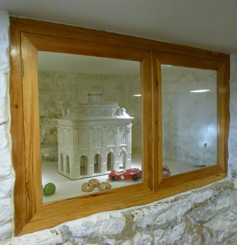 A miniature version of the county hall - and some buns - next to the stairway down to Buns in the Basement in Abingdon-on-Thames