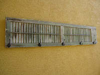 hooks on shutter for outdoor towel storage solution