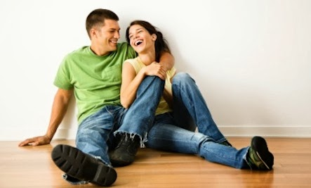 9 Myths About Soul Mate Relationships - man woman sitting sit wooded floor happy couple love romance
