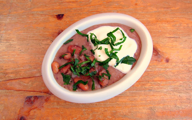 pressure cooked refried beans in white oval ramekin