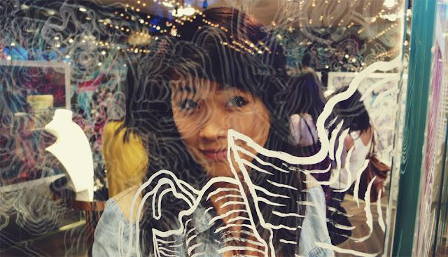 belinda love lee girl behind James Jean painted glass