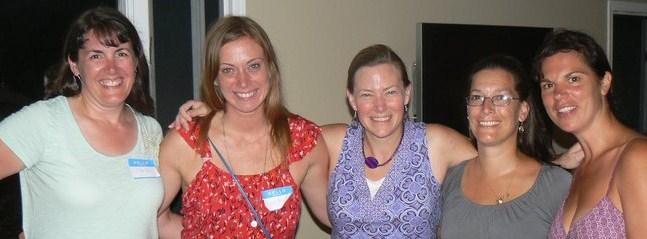 Katie Meyler, wearing red with Heartworks Ladies