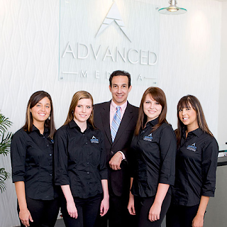 Dr Gonzalez with his staff, accused of permanently injuring patients performing plastic surgery without training