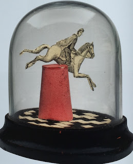 A Leaping Horse in a Bell Jar by Joseph Cornell